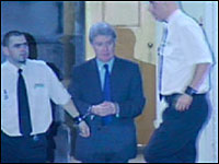 John (Jack) Walker being escorted from the High Court after sentencing.  Image taken from BBC News at  http://news.bbc.co.uk/1/hi/scotland/edinburgh_and_east/6099842.stm