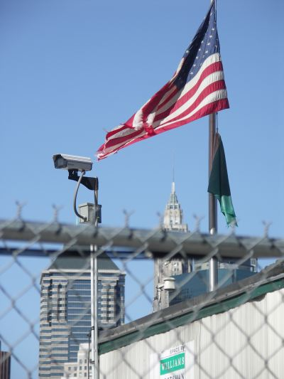 Flag and skyscraper; fence and camera #1
