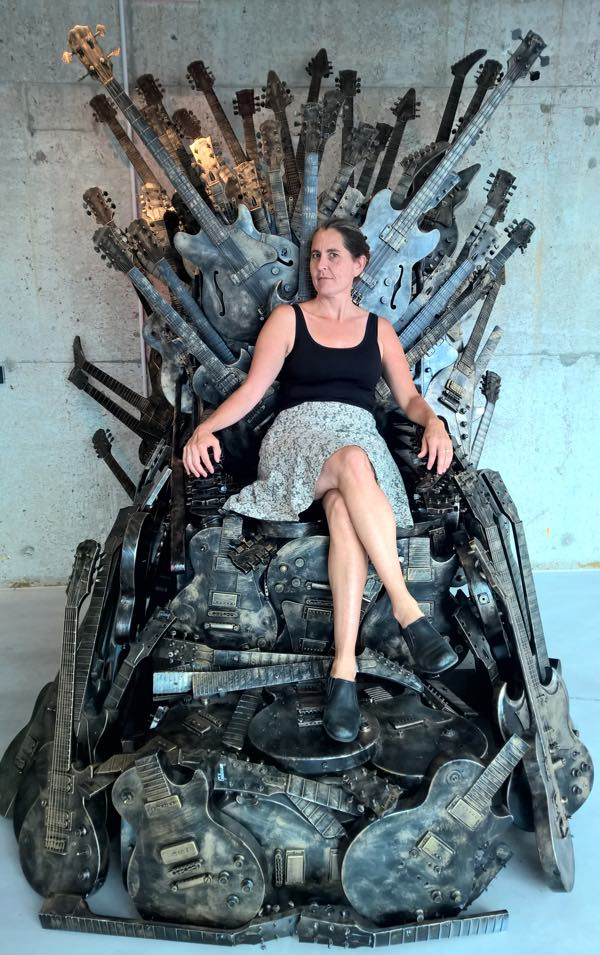 Abi on the iron throne of guitars at Adam Toren