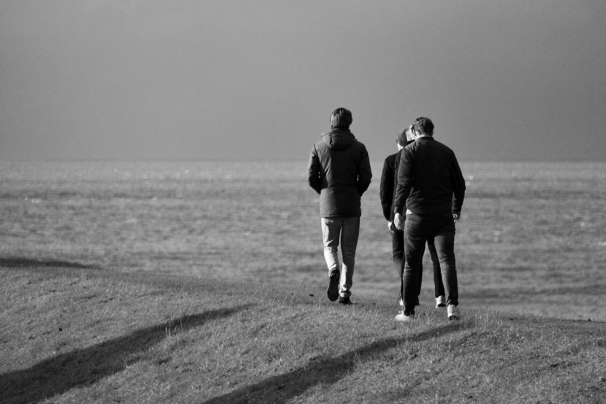 Men walking on the sea dyke at Hindeloopen