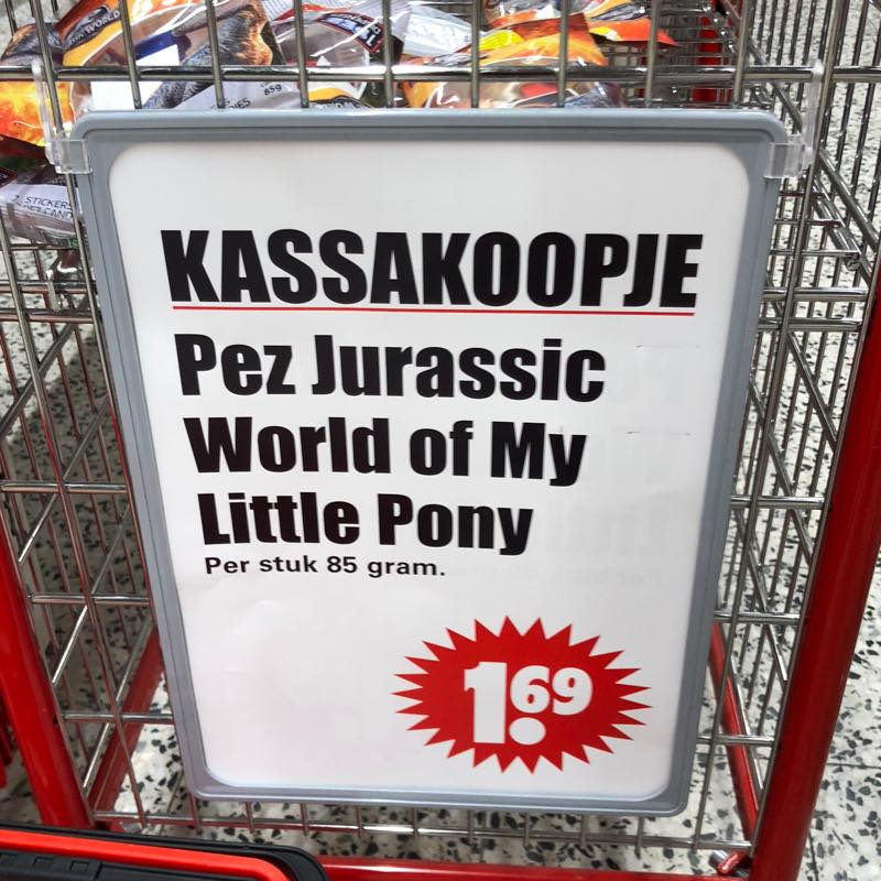 Supermarket checkout sign with text: Pez Jurassic World of My Little Pony