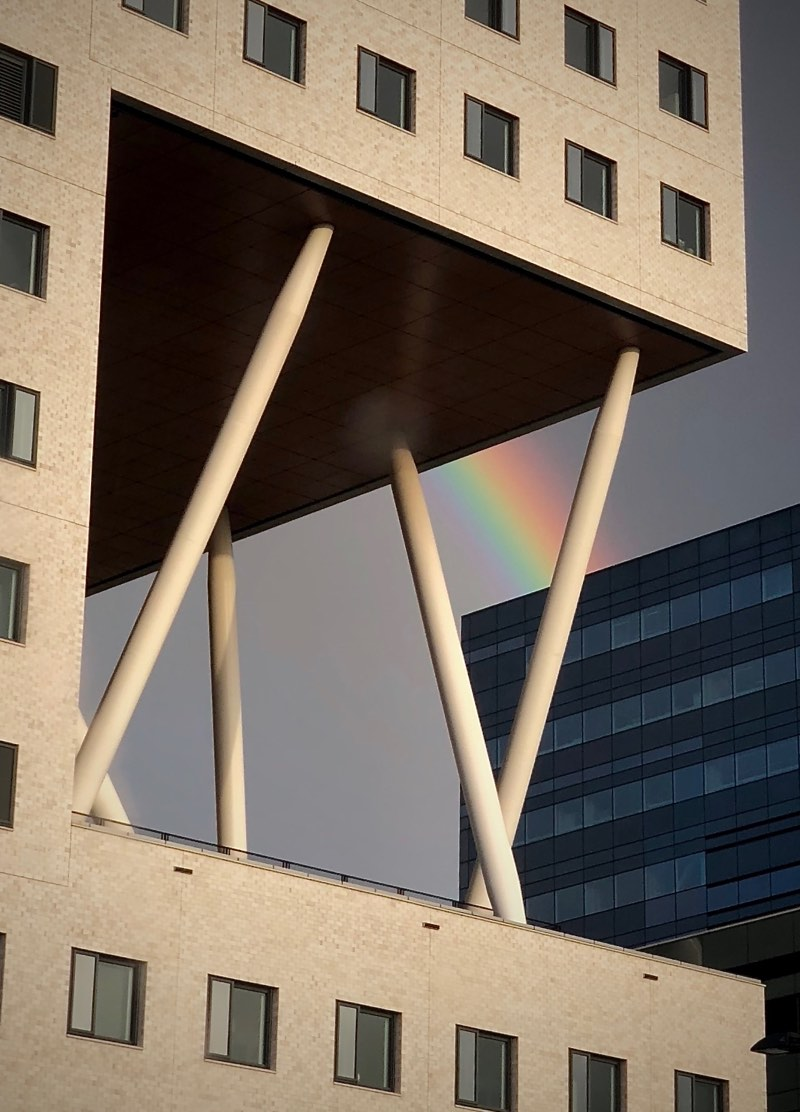 Rainbow caught through the cantilever pillars of the O|2 Building for Human Life Sciences at Zuidas Amsterdam